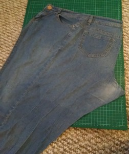 Jeans cut along inside leg and crotch seams