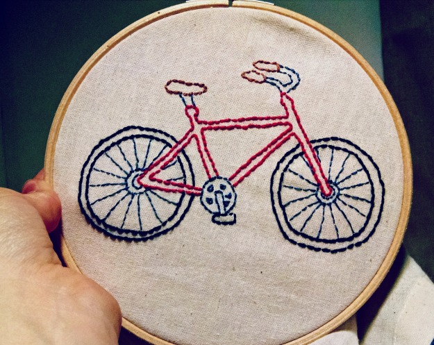 Backstitched embroidered bike in embroidery hoop