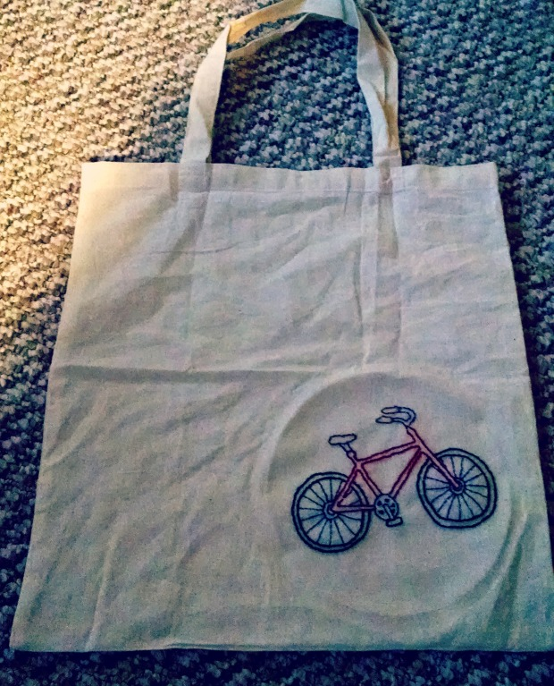 Backstitched embroidered bike on a tote bag